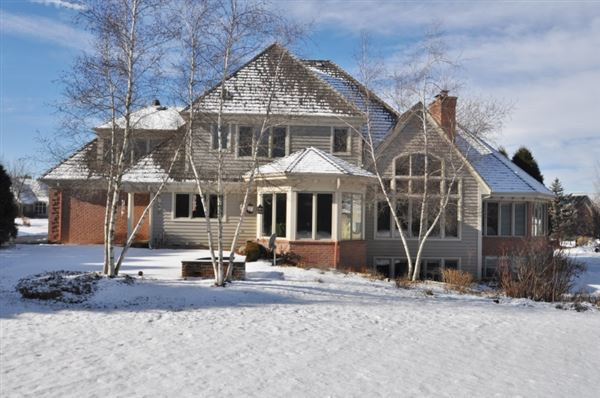 Luxury real estate this wonderful house is set on a private lot with treed backdrop