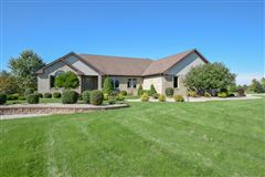 Impeccably maintained executive brick ranch luxury homes