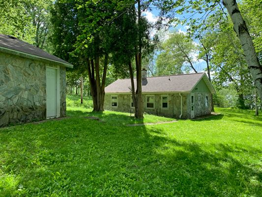 rare four-plus acres on Big Cedar Lake mansions