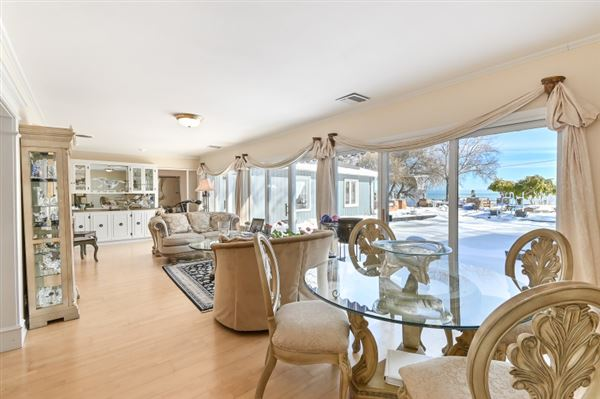enjoy spectacular lake views from this extraordinary residence luxury homes