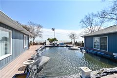 Luxury properties enjoy spectacular lake views from this extraordinary residence
