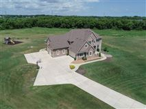 Impressive executive home on two-plus acres luxury properties