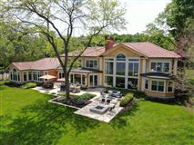 Luxury homes in South Beach inspired home on Oconomowoc Lake