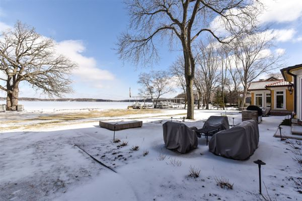 South Beach inspired home on Oconomowoc Lake luxury real estate