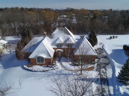 Luxury properties this wonderful house is set on a private lot with treed backdrop