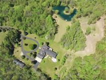 Luxury homes this spectacular wooded property boasts Milwaukee River frontage
