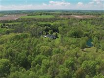 this spectacular wooded property boasts Milwaukee River frontage luxury homes