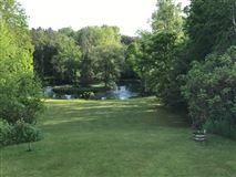 Luxury real estate this spectacular wooded property boasts Milwaukee River frontage