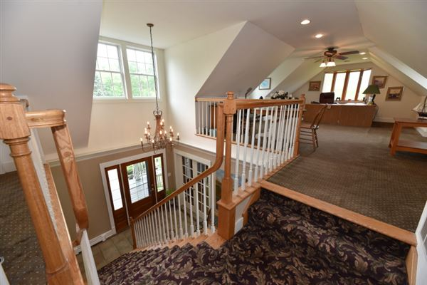 this spectacular wooded property boasts Milwaukee River frontage luxury real estate