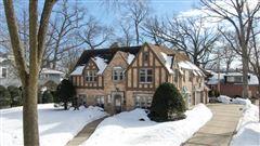 exquisite Tudor home luxury homes