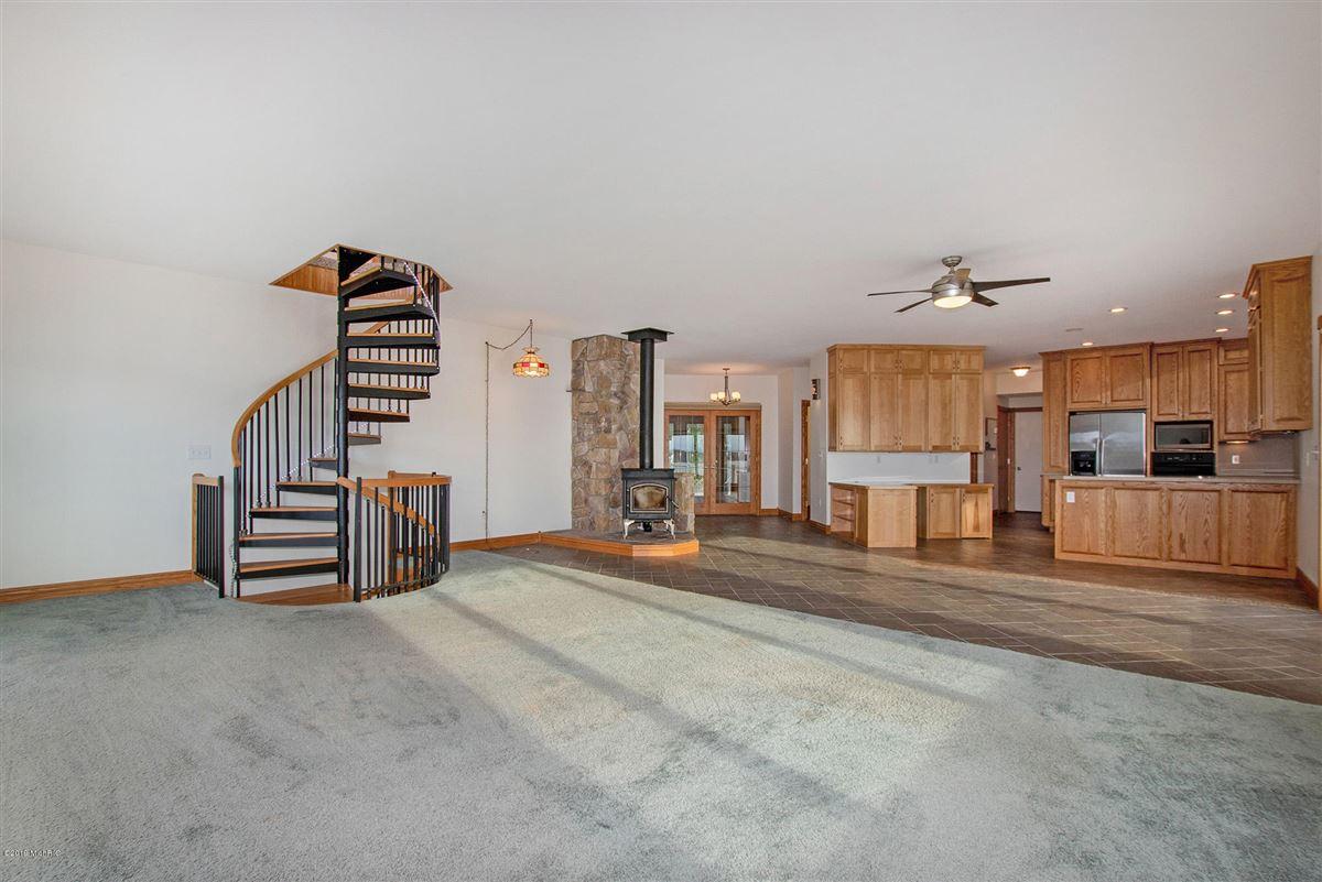 custom built home offers a spacious open floor plan luxury properties