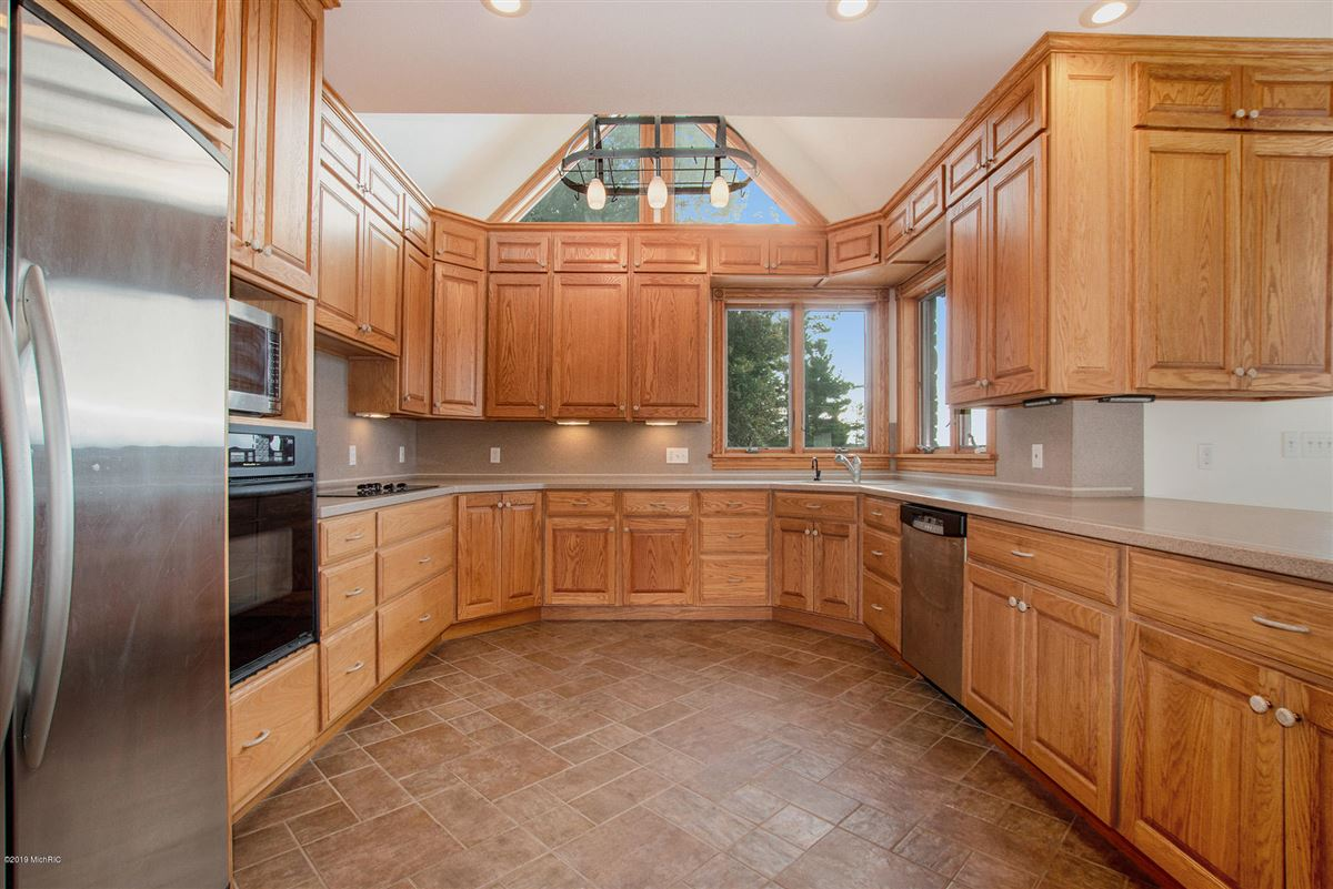 custom built home offers a spacious open floor plan mansions