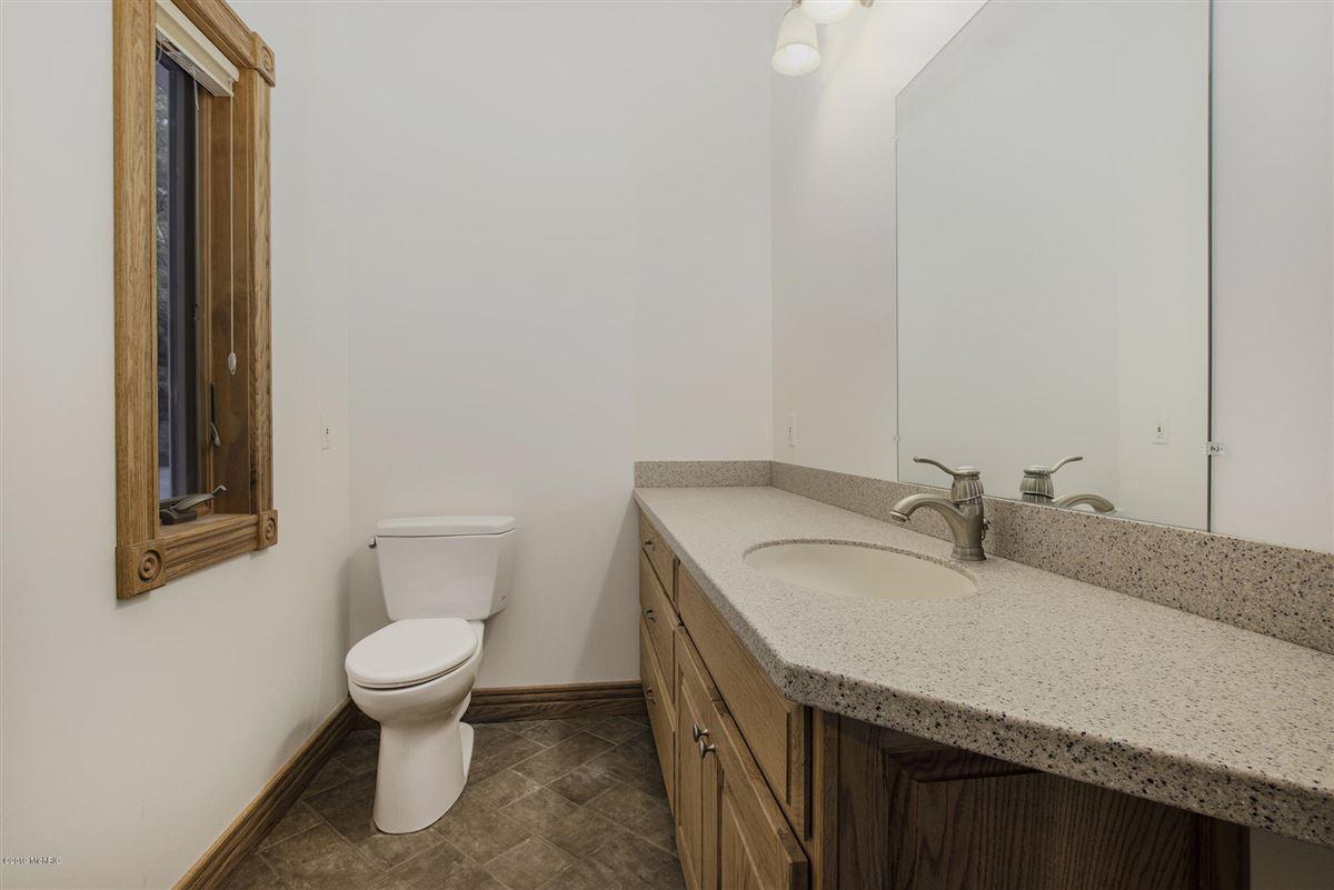 custom built home offers a spacious open floor plan luxury homes