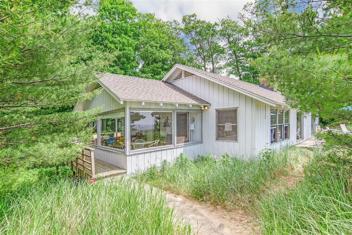 two charming adjacent Lake Michigan cottages luxury homes