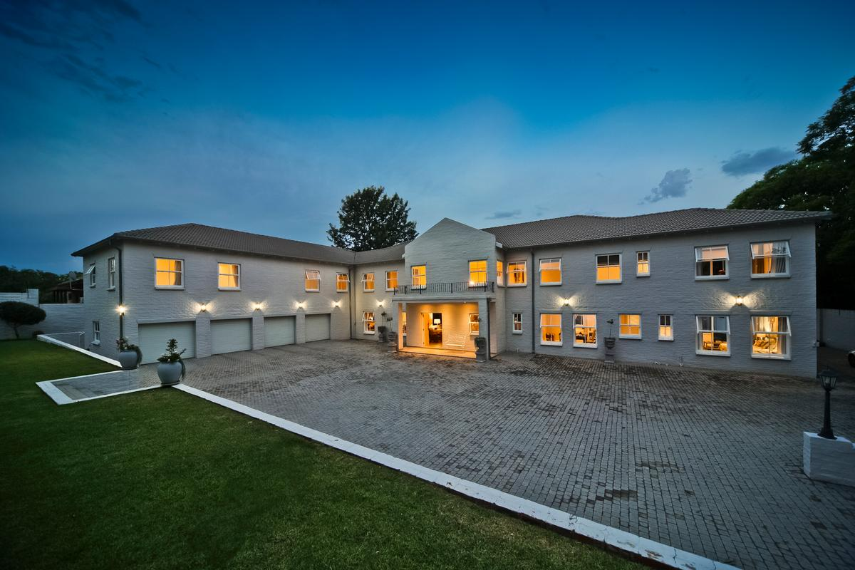 Home with 4 garages and tennis court luxury properties