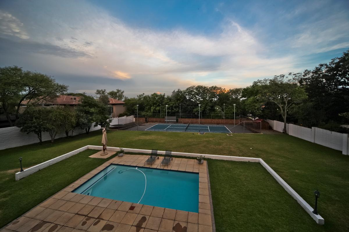 Home with 4 garages and tennis court luxury homes