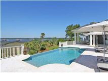 Luxury homes in a meticulously kept luxurious waterfront estate