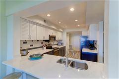 Welcome to a magnificent third floor luxury condominium luxury properties