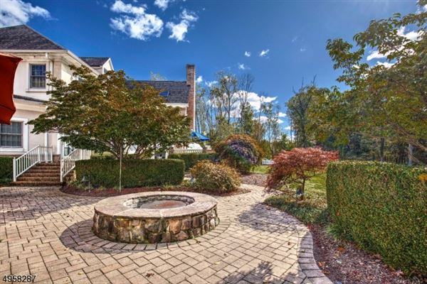 Luxury homes exceptional custom home is situated on 10.14 acres of open and wooded land