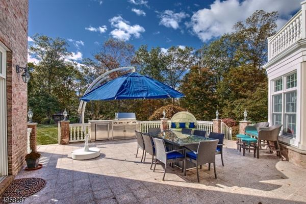 exceptional custom home is situated on 10.14 acres of open and wooded land  luxury homes