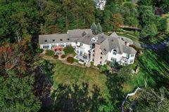 Luxury real estate exceptional custom home is situated on 10.14 acres of open and wooded land