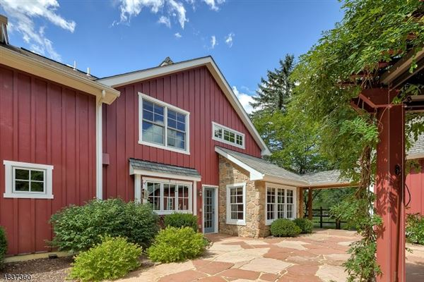 Magnificently restored and expanded converted barn luxury homes