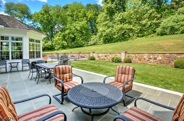 This gracious Georgian Colonial, perfectly sited on a gentle slope to capture spectacular sweeping views luxury real estate
