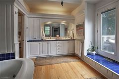 Luxury homes in this charming cottage is enveloped in privacy
