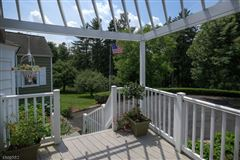 Luxury real estate this charming cottage is enveloped in privacy