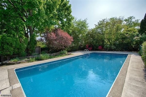 Luxury properties This sunny property offers a yard and heated pool