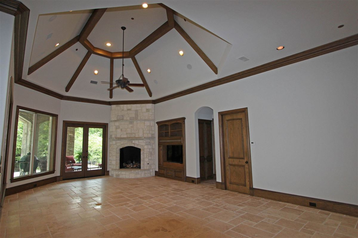 LUXURIOUS home on wooded lot in Chapel Creek luxury real estate