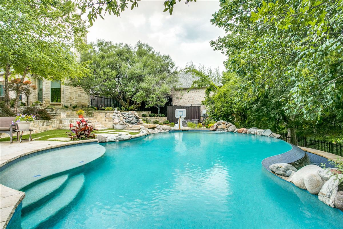 LUXURIOUS home on wooded lot in Chapel Creek luxury properties