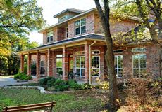 Luxury properties beautiful brick home and 254 acre ranch