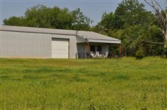 Mansions in beautiful brick home and 254 acre ranch
