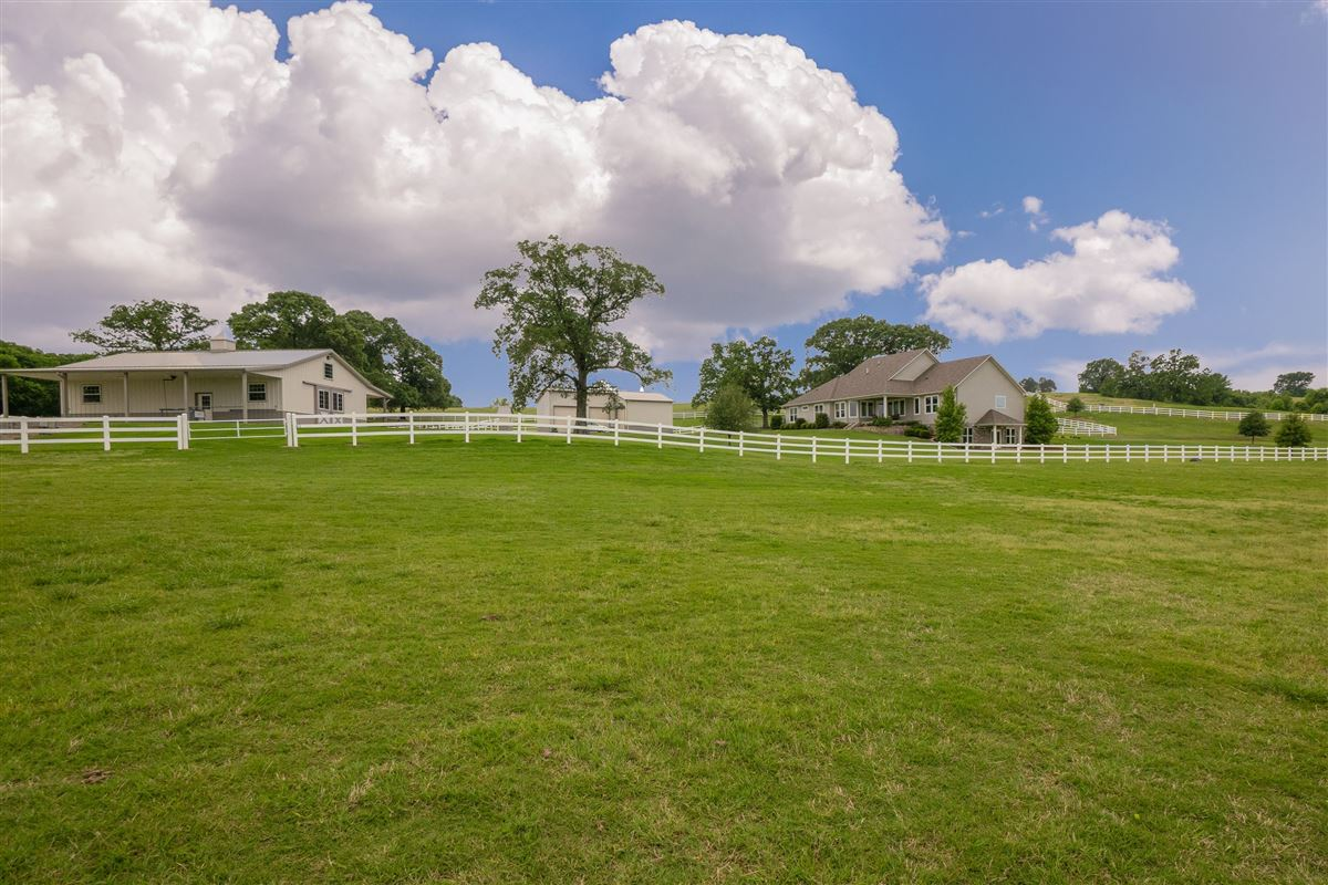 Luxury properties 19.4 stunning acres with a horse barn