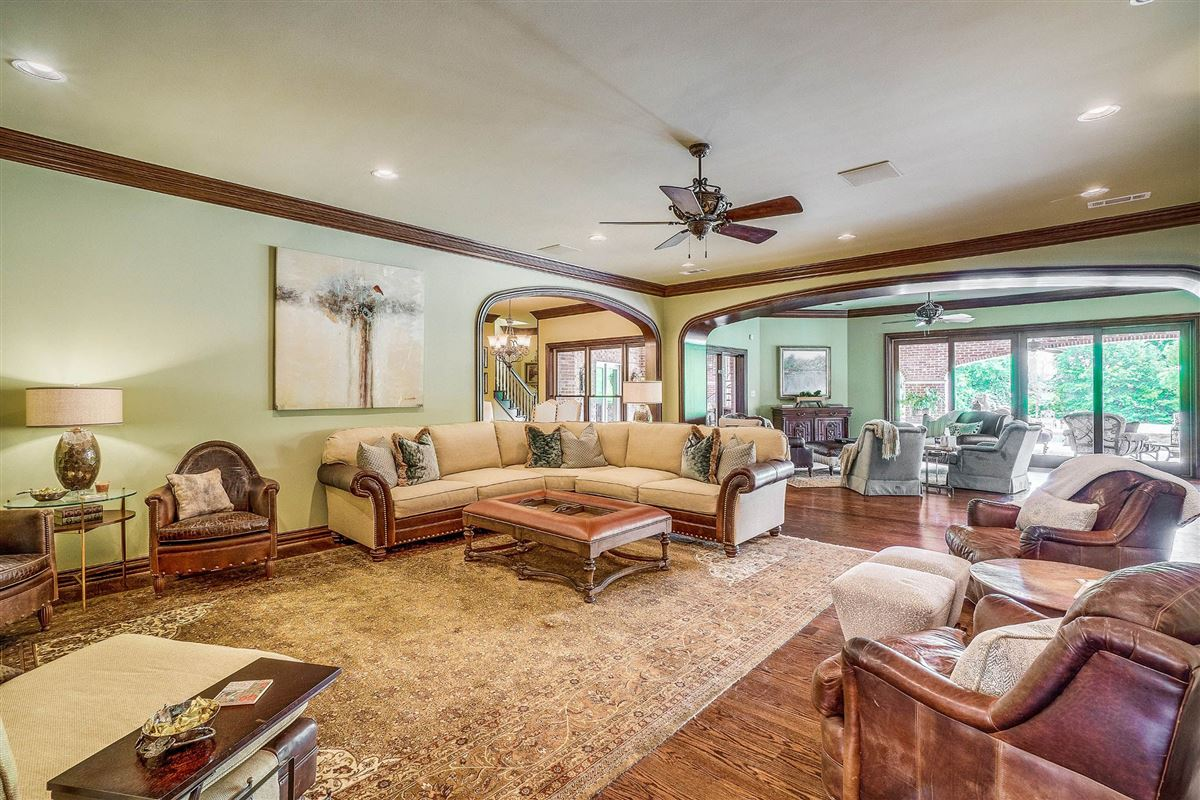 grand three-story residence on two wooded acres luxury real estate