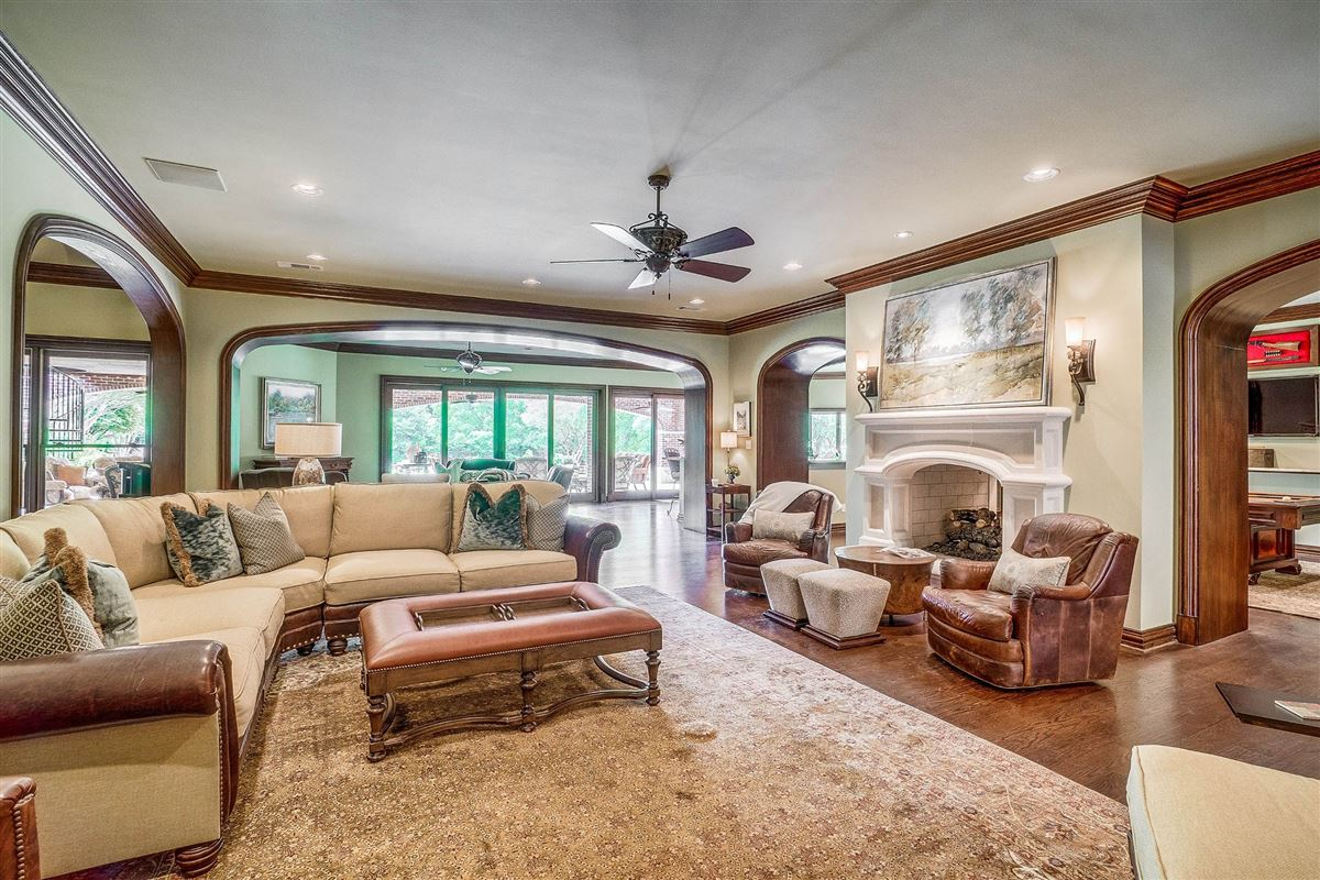 Luxury properties grand three-story residence on two wooded acres