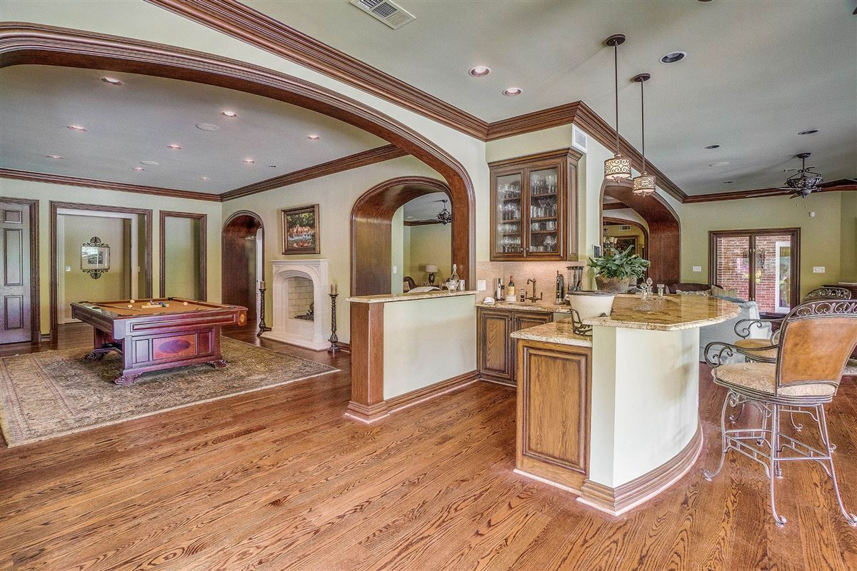 grand three-story residence on two wooded acres luxury properties
