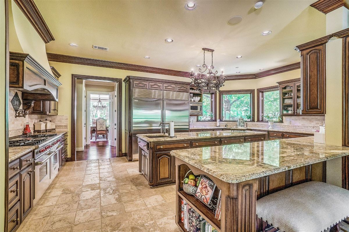Luxury homes in grand three-story residence on two wooded acres
