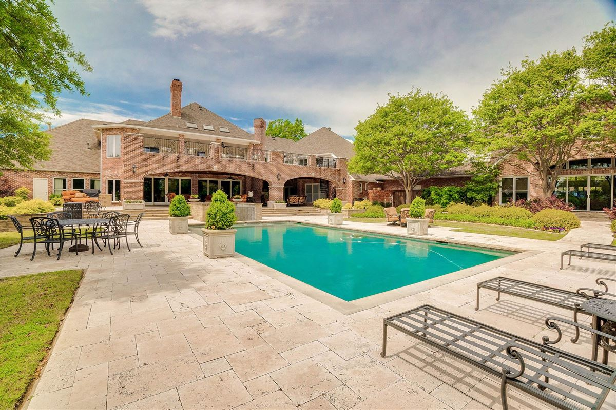 Luxury homes grand three-story residence on two wooded acres