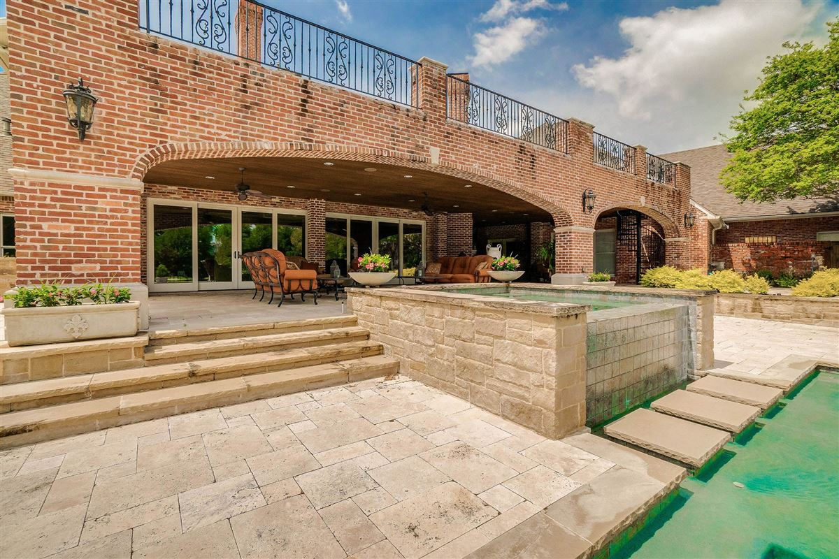 grand three-story residence on two wooded acres luxury homes