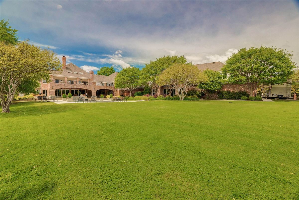 Luxury real estate grand three-story residence on two wooded acres