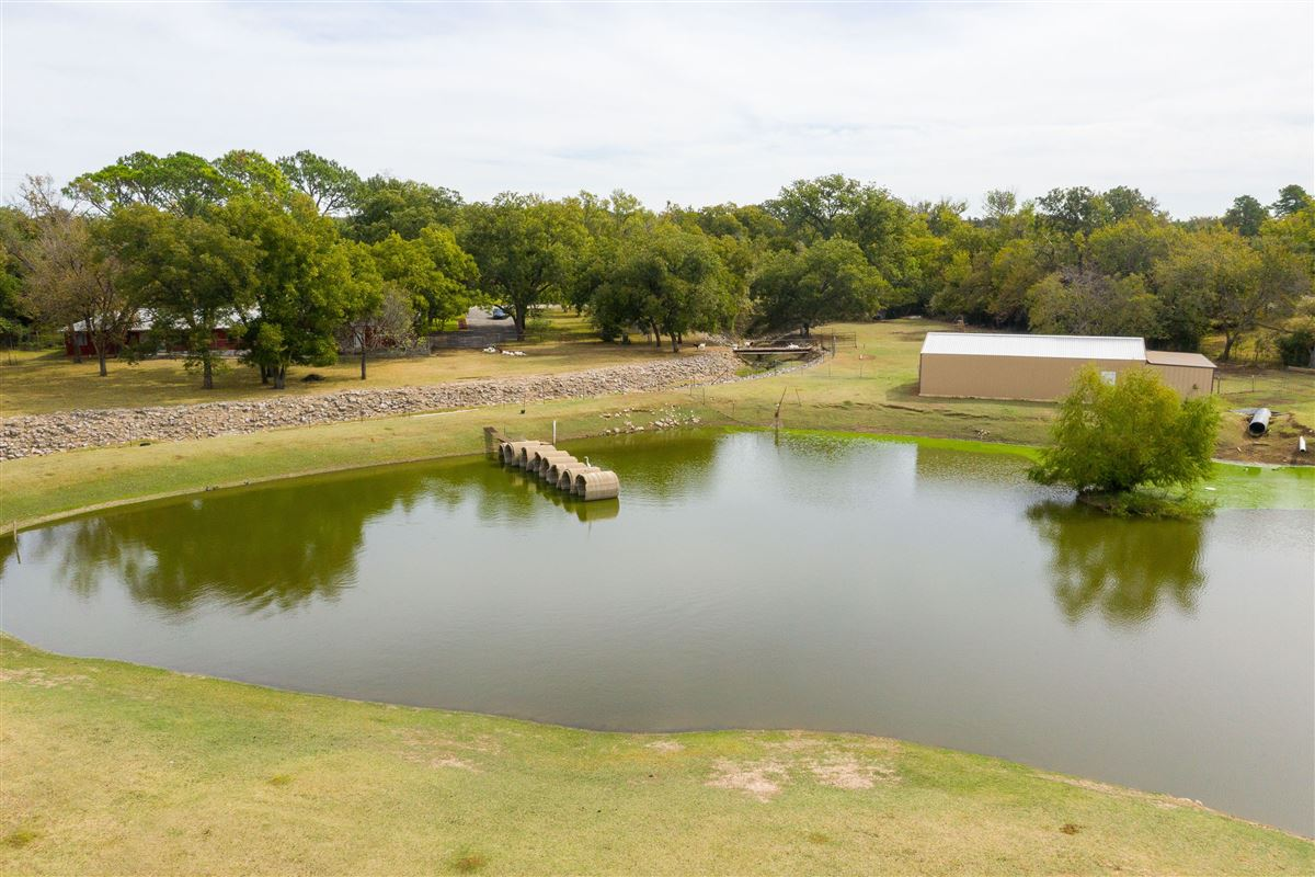 spacious home with views of pond luxury properties