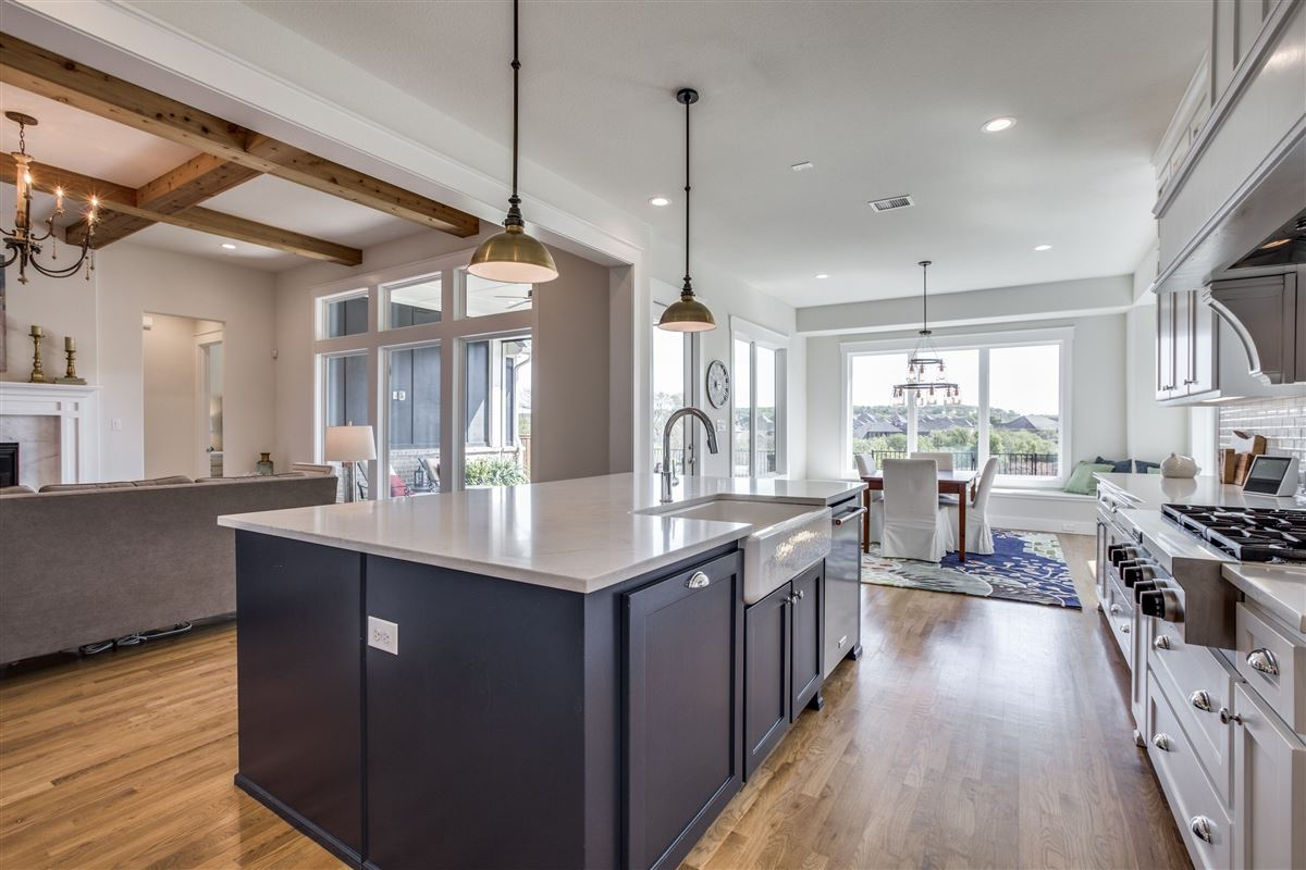 Luxury properties impressive Stonegate custom home
