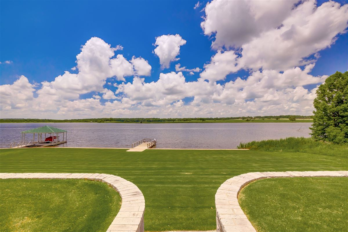 this beautiful, peaceful and tranquil property boasts stunning lake views luxury homes