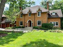 Gracious center entrance brick home mansions