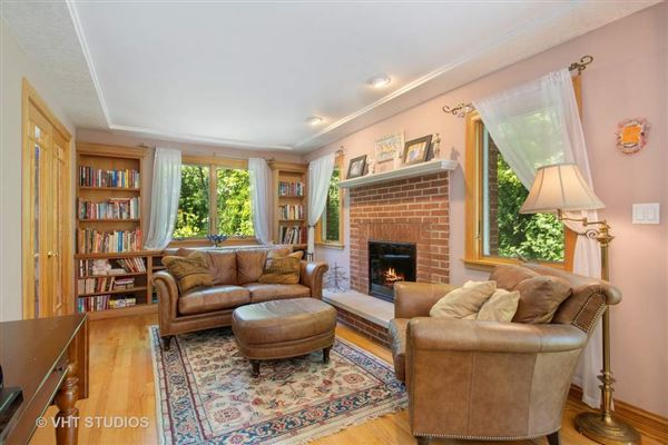 lovely home includes 2 fireplaces and a large yard luxury real estate