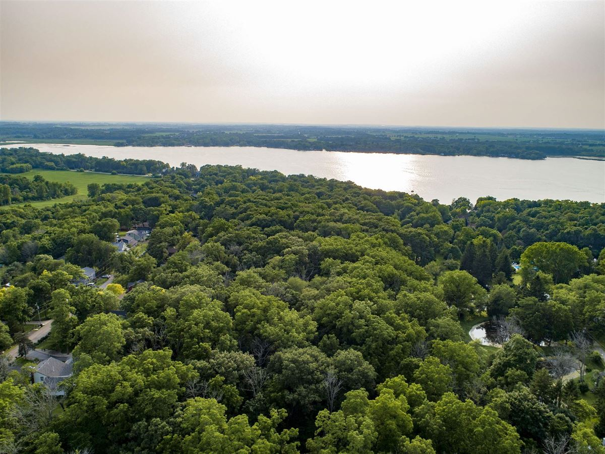 Luxury properties gorgeous home with sweeping sunset views of Lake Elizabeth