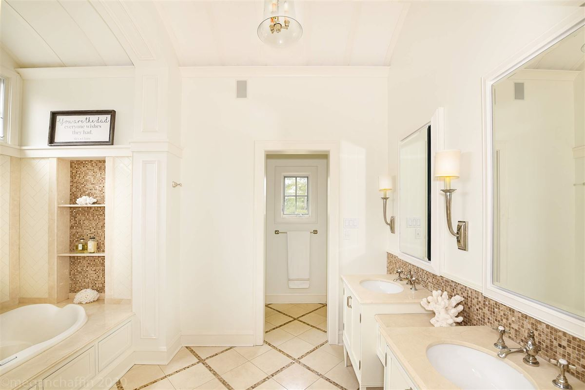Mansions in beautifully renovated classic East Wilmette colonial