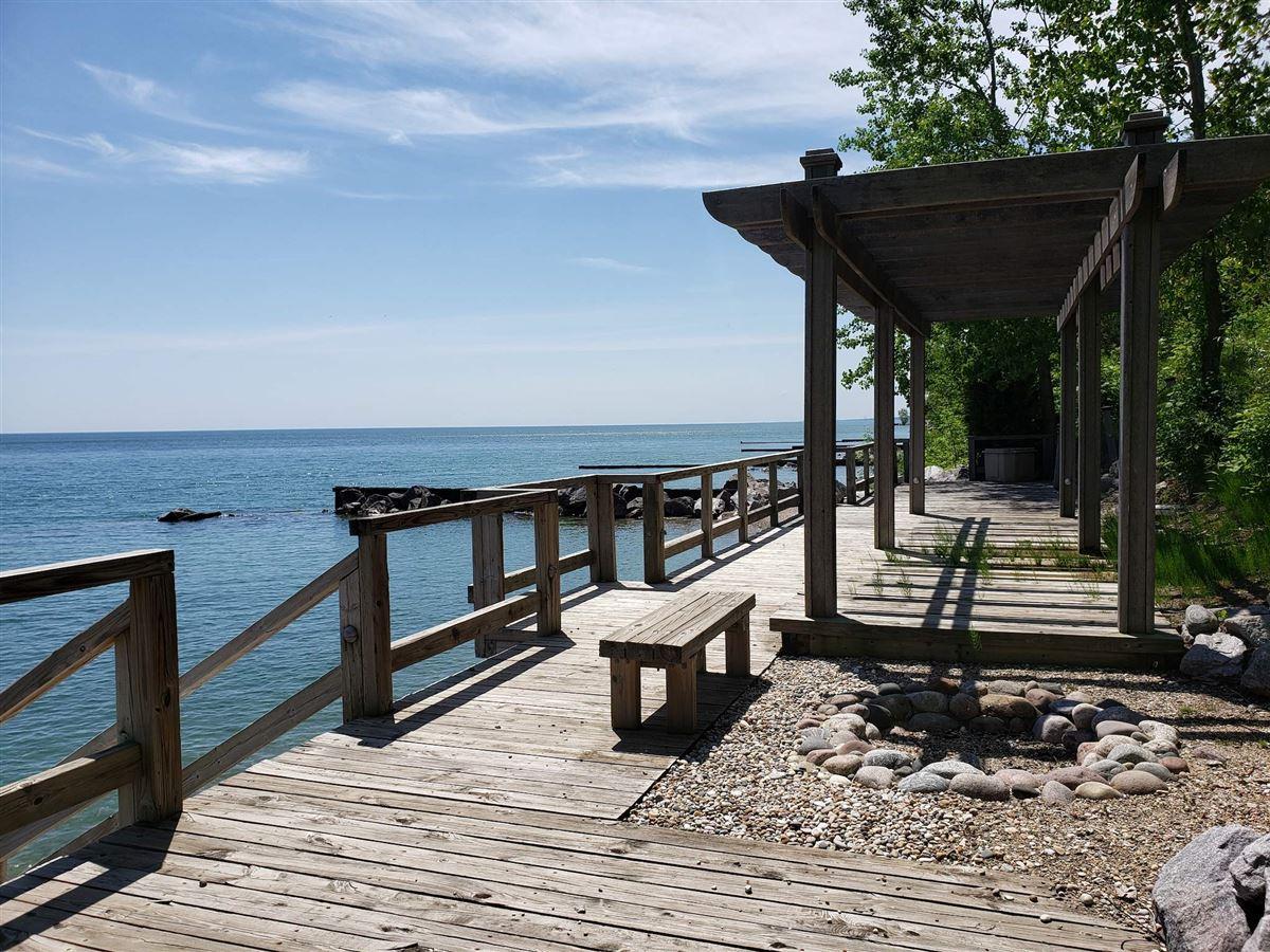 Luxury properties magnificent 12-plus-acre estate on Lake Michigan